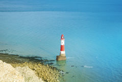 Aerial view to Beachy Head Lighthouse with blue turquoise water of English channel at the background and white chalk stones of cli Stock Photos