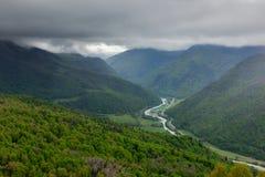 Aerial view to Bolshoy Zelenchuk river valley. Under heavy thunderstorm clouds Arkhyz, Karachaevo-Cherkessia, Russia Royalty Free Stock Image