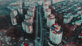 Aerial view to the city at sunset with traffic and buildings, 4k, Ternopil, Ukraine stock video