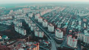 Aerial view to the city at sunset with traffic and buildings, 4k, Ternopil, Ukraine stock footage