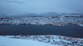 Tromso town in winter. Aerial view to the city of Tromso in winter from above, Northern Norway stock footage