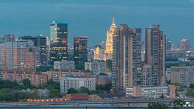 Aerial view to cityscape skyline with World Trade Center towers and hotel Ukraine day to night timelapse in Moscow. Aerial view to cityscape skyline with World stock footage