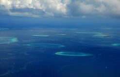 Aerial view to coral reef rounded formations Stock Images
