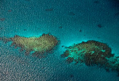 Aerial view to coral reefs in ocean Stock Images