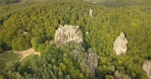 Aerial view to Dovbush Rocks in Bubnyshche, Carpathian mountains, Ukraine. Aerial view to Dovbush Rocks in Bubnyshche - a legendary place, the ancient cave stock video footage