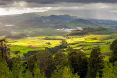 Aerial view to San Miguel island. Aerial view to fields of San Miguel island under heavy rain and sun simultaneously, Azores, Portugal Stock Images