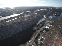Aerial view to filling in the winter covered with snow. Royalty Free Stock Photos