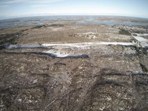 Aerial view to filling in the winter covered with snow. royalty free stock images