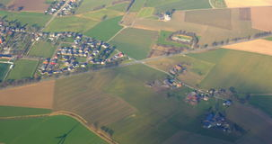 Aerial view to the green fields and small town