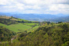 Aerial view to the green hills, forest and town nearby Bologna t. Own Royalty Free Stock Images