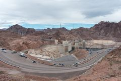 Aerial view to the Hoover Dam and the road around Stock Photo