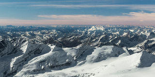 Aerial view to many snowy mountain tops Royalty Free Stock Images