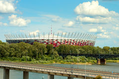 Aerial view to the National stadium in Warsaw. Aerial view to the `Stadion Narodowy` National stadium in Warsaw, Poland. Hot summer landscape of river Vistula Stock Image