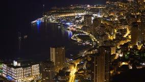 Aerial view to night brightly illuminated luxurious Principality of Monaco. Stock footage stock footage