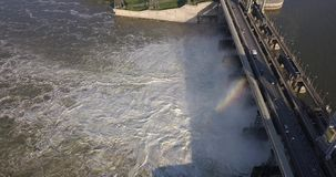 Aerial view to the Novosibirsk hydroelectric power station. With waterfall on a sunny summer windless day with rainbow stock video footage
