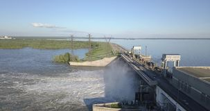 Aerial view to the Novosibirsk hydroelectric power station. With waterfall on a sunny summer windless day with rainbow stock footage