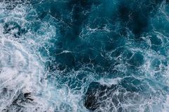 Aerial view to ocean waves. Water background. Aerial view to ocean waves. Blue water background royalty free stock images