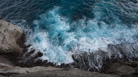Aerial view to ocean waves and rock coast. Aerial view to ocean waves and coast Royalty Free Stock Photos