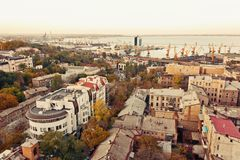 Aerial view to Odessa, roofs, port and sea at sunset or sunrise Stock Image