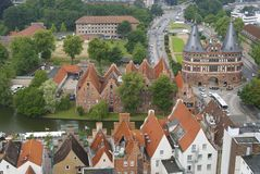 Aerial view to the old city and Holstentor city gate in Lubeck, Germany. Stock Image