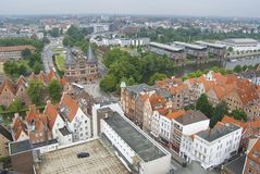 Aerial view to the old city and Holstentor city gate in Lubeck, Germany. Royalty Free Stock Image