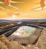 Aerial view to opencast mine. Use drones to inspect mining area. Modern technology theme stock photography