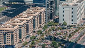 Aerial view to parking lot outdoors vehicles in Dubai downtown timelapse. Aerial view to parking lot with trees outdoors vehicles in Dubai downtown timelapse stock video footage