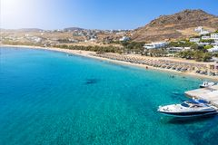 Aerial view to Kalafatis Beach on Mykonos island, Cyclades, Greece. Aerial view to the popular Kalafatis Beach on Mykonos island with pristine, clear sea royalty free stock photos