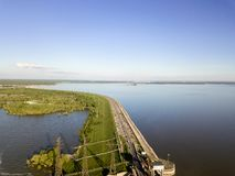 Aerial view to the road. Going near the sea to the Novosibirsk hydroelectric power station on a sunny summer windless day Stock Photos