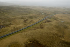 Aerial view to road and landscape. Aerial view from helicopter road in Iceland Royalty Free Stock Image