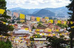 Aerial view to San Cristobal de las Casas with numerous religious flags stock image