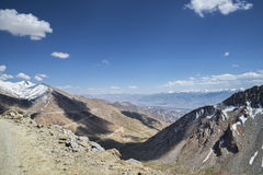 Aerial view to serpentine road, mountain range and valley Stock Photo