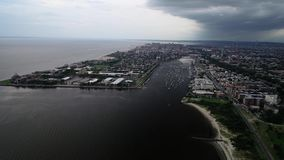 View to Sheepsheadbay area in Brooklyn, NY from the drone with effective clouds at sunset time in New York stock video footage
