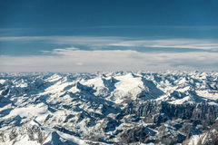 Aerial view to snowy mountain peaks Royalty Free Stock Photos