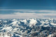 Aerial view to snowy mountain peaks Royalty Free Stock Photos