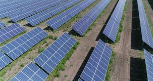 Aerial view to solar power plant. Industrial background on renewable resources theme. flying over rows of solar panels. Solar panels, solar panels on the field stock footage