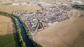 Aerial view to street and buildings and fields. Aerial view to street and buildings in Santovenia de pisuerga, Valladolid, Spain Royalty Free Stock Image