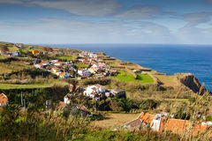 Aerial view to town over ocean. Aerial view to town over Atlantic ocean, San Miguel, Azores, Portugal Royalty Free Stock Images