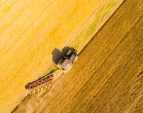 Aerial view to a Tractor with plough working on a field. stock images