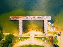 Aerial view to tropical beach. Aerial view to tropical beach with many people who are enjoying summer holidays. Leisure activities from above Stock Photo