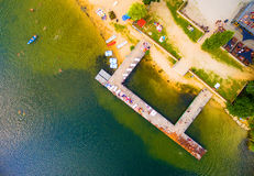 Aerial view to tropical beach. Aerial view to tropical beach with many people who are enjoying summer holidays. Leisure activities from above Royalty Free Stock Photography