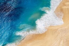 Aerial view to tropical sandy beach and blue ocean. Aerial view to tropical sandy beach and blue sea ocean wave stock photography