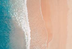 Aerial view to tropical sandy beach and blue ocean. Top view of ocean waves reaching shore on sunny day. Palawan, Philippines. Aerial top view of turquoise ocean royalty free stock photos