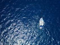 Aerial view to two Yachts in deep blue sea. Drone photography. Amasing aerial view to two Yachts in deep blue sea. Drone photography stock photography