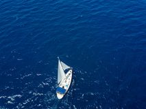 Aerial view to two Yachts in deep blue sea. Drone photography. Amasing aerial view to two Yachts in deep blue sea. Drone photography royalty free stock photography