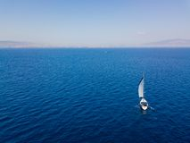 Aerial view to two Yachts in deep blue sea. Drone photography. Amasing aerial view to two Yachts in deep blue sea. Drone photography royalty free stock photo