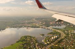 Aerial view to wing of an airplane over Moscow Region. Aerial view to the wing of an airplane over Moscow Region Stock Photos