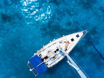 Aerial view to Yacht in deep blue sea. Drone photography. Amasing aerial view to Yacht in deep blue sea with relaxing kids. Drone photography royalty free stock photography