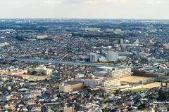 Aerial view of Tokyo apartments in cityscape background. Residential district in smart city in Asia with river. Buildings at noon. Japan stock photos