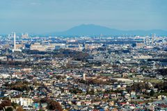 Aerial view of Tokyo apartments in cityscape background. Residential district in smart city in Asia. Buildings at noon. Japan royalty free stock photo
